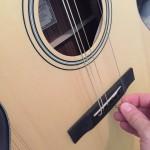 stringing a guitar - holes