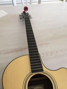 stringing a guitar - fretboard