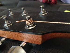 stringing a guitar - winding