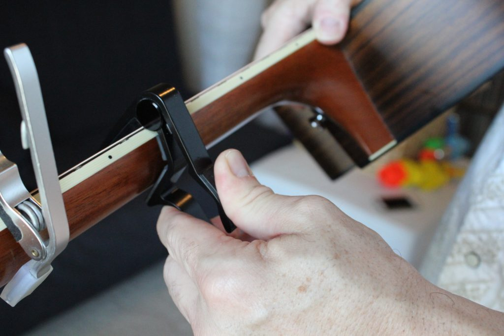 Gripping the Dunlop capos