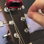 stringing a guitar - tuning hardware